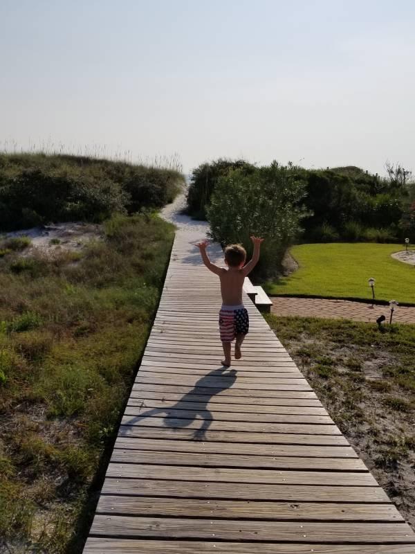 Boy enjoying a Cape San Blas beach vacation